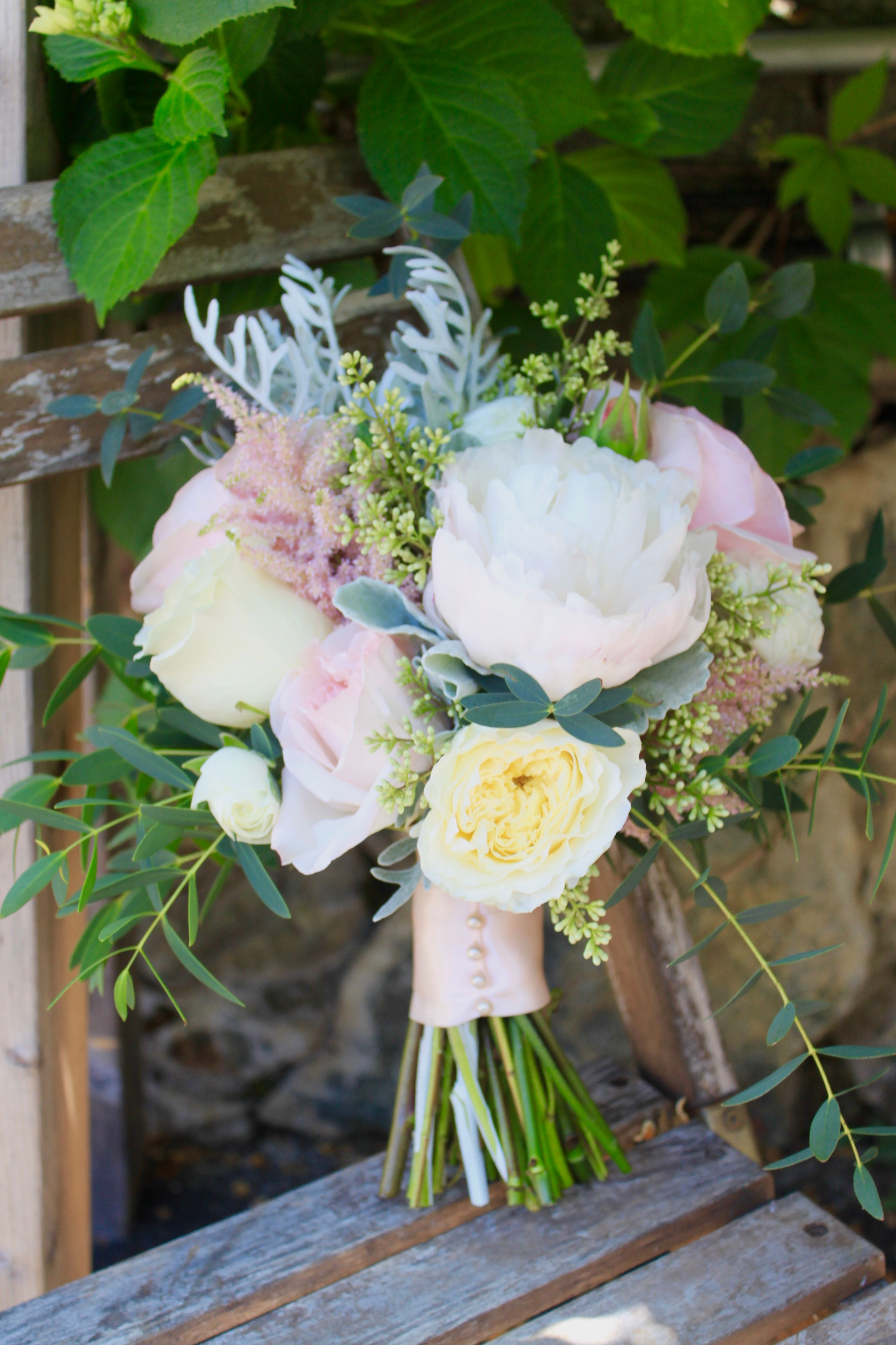 A summer garden bouquet of roses, peony, dusty miller, eucalyptus, astilbe and ranunculus by Foxgloves Flowers